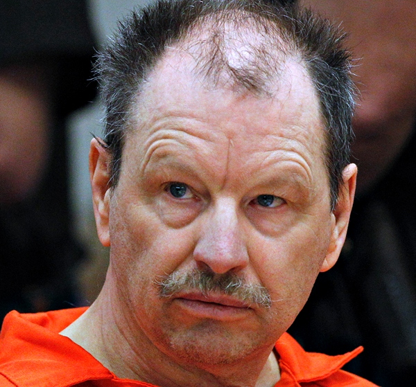"Green River Killer Gary Ridgway listens during his arraignment on charges of murder in the 1982 death of Rebecca ""Becky"" Marrero, Friday, Feb. 18, 2011, at the King County Regional Justice Center in Kent., Wash. Ridgway already confessed to killing Marrero as part of a 2003 plea deal that spared him the death penalty. (AP Photo/Elaine Thompson)"